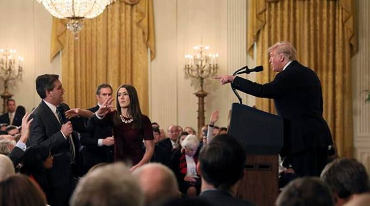 A White House staff member reaches for the microphone held by CNN's Jim Acosta as he questions US President Donald Trump during a news conference following Tuesday's midterm US congressional elections at the White House in Washington on Wednesday. (Reuter