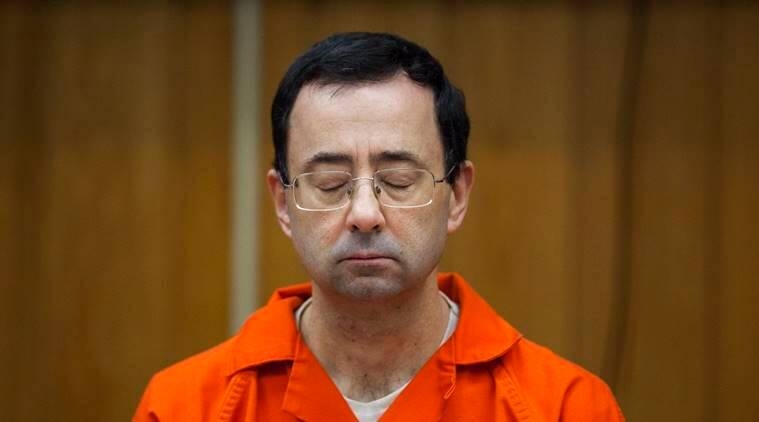 Larry Nassar listens during his sentencing at Eaton County Circuit Court in Charlotte, Michigan.