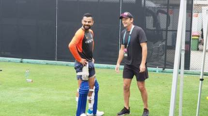 Kohli shares a laugh with Gilchrist in Brisbane