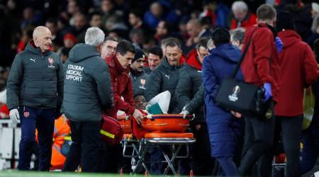 Arsenal's Danny Welbeck leaves the pitch on a stretcher after sustaining an injury