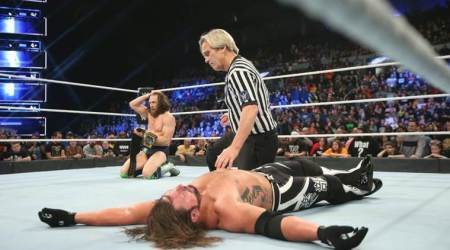 Bryan lands low blow on Styles to win title
