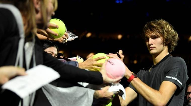 Alexander Zverev signs his autograph for fans