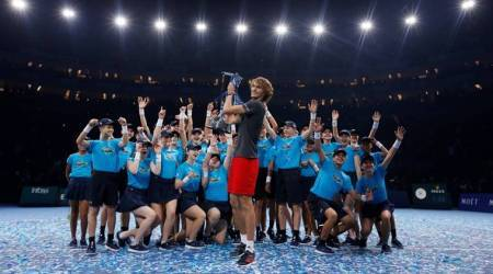 Germany's Alexander Zverev celebrates with the trophy after winning the final against Serbia's Novak Djokovic