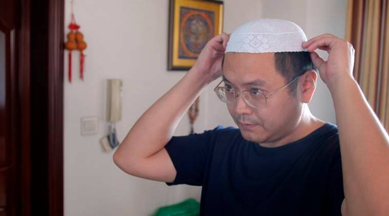 Poet fears for his people as China 'Sinicizes' religion