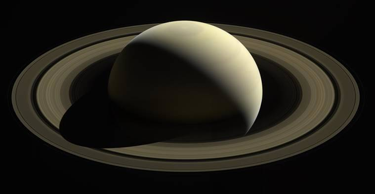 In an image from NASA, a view of Saturn from the Cassini spacecraft.