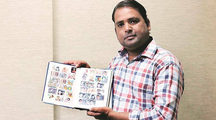 Sandeep Boyat with his stamp collection. Express