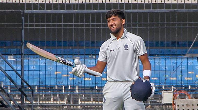 Madhya Pradesh's Ajay Rohera celebrates after making a world record for slamming the highest first-class score on debut, an unbeaten 267 against Hyderabad in their Ranji Trophy Elite Group B, in Indore