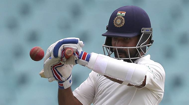 Pujara keeps India afloat on day of brilliant Aussie fielding