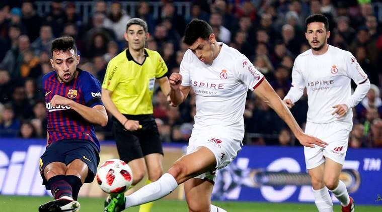 FC Barcelona's Munir El Haddadi, left, kicks the ball to score during a Spanish Copa del Rey soccer match between FC Barcelona and Cultural Leonesa at the Camp Nou stadium in Barcelona, Spain