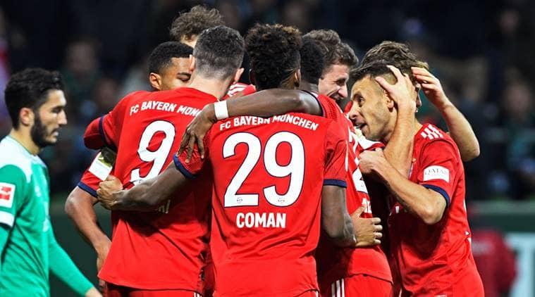 Bayern Munich's Serge Gnabry celebrates scoring their second goal with team mates