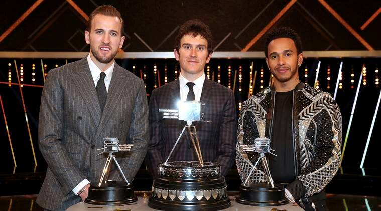 Geraint Thomas, center, poses after winning the BBC Sports Personality of the Year award alongside third placed Harry Kane, left, and second placed Lewis Hamilton during the BBC Sports Personality of the Year 2018 at Birmingham Genting Arena