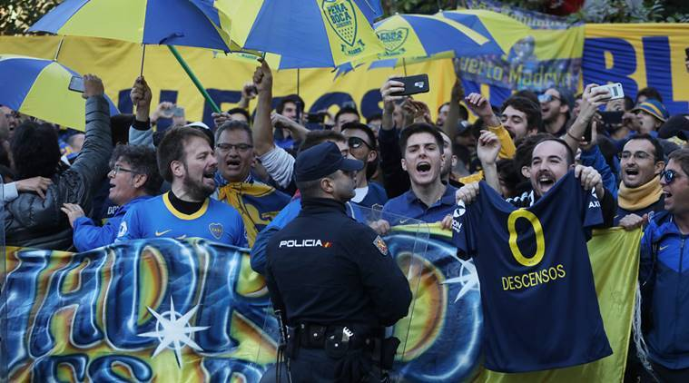 Boca Juniors fans and police outside the team hotel as the Boca Juniors team coach arrives