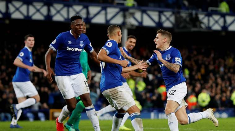 Everton's Lucas Digne celebrates scoring their second goal against Watford with team mates