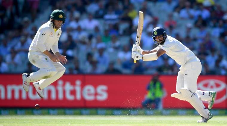 Australia's Aaron Finch, left, jumps to avoid a shot from India's Cheteshwar Pujara during play on day one of the third cricket test between India and Australia in Melbourne, Australia