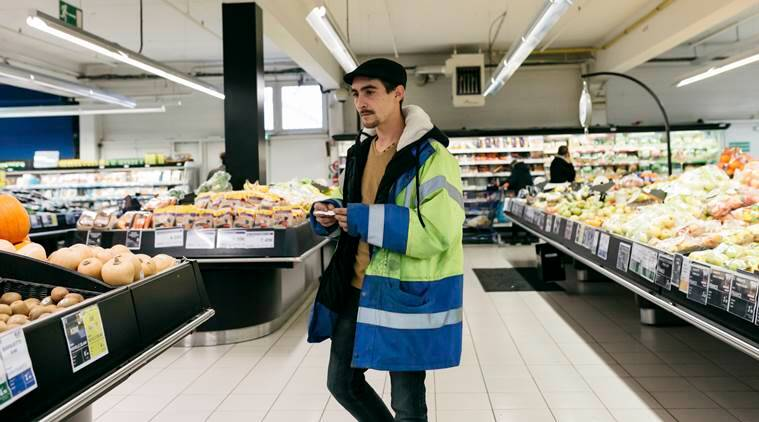 A protester, Florian Dou, goes grocery shopping
