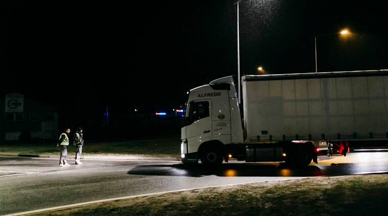 Yellow Vest protesters stop a truck at a roundabout in Guéret, France.