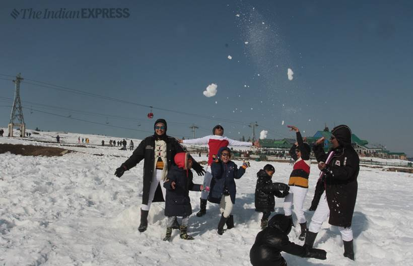 Tourists enjoy second phase ride near the Affarwat peaks in Gulmarg on New Year eve. (Express Photo by Shuaib Masoodi)