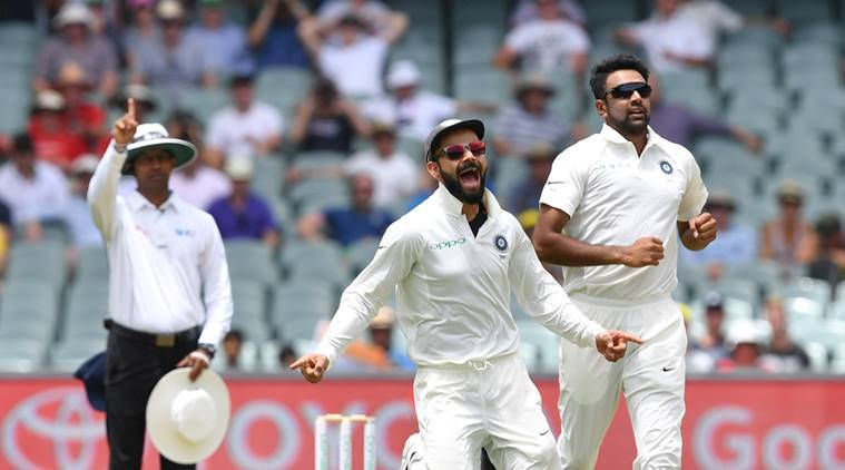 India's captain Virat Kohli and his teammate Ravichandran Ashwin celebrate the dismissal of Australia's Marcus Harris during day two of the first test match between Australia and India at the Adelaide Oval in Adelaide