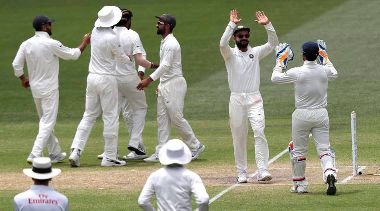 Indian players celebrate the dismissal of Australia's Tim Paine on the final day of the first cricket test between Australia and India in Adelaide, Australia
