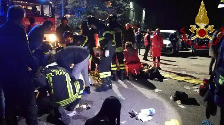 Emergency personnel attend to victims of a stampede at a nightclub in Corinaldo near Ancona Italy