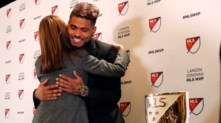 Atlanta United soccer player Josef Martinez is embraced by Angie Blank wife of team owner Arthur Blank after it was announced he had won the Landon Donovan MLS MVP award