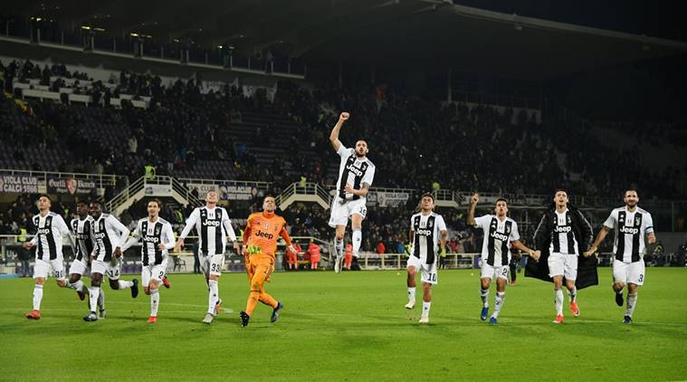 Juventus players celebrate after the match against Fiorentina
