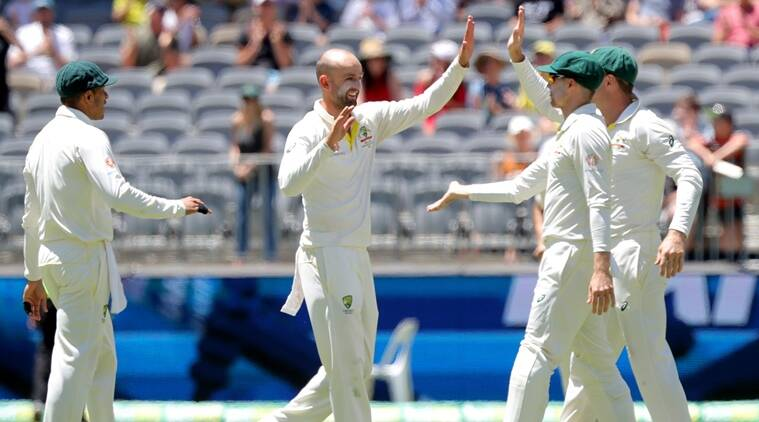 Australia's Nathan Lyon (2nd L) is congratulated by his teammates after dismissing India's Rishabh Pant on day five of the second test match between Australia and India at Perth Stadium in Perth, Australia