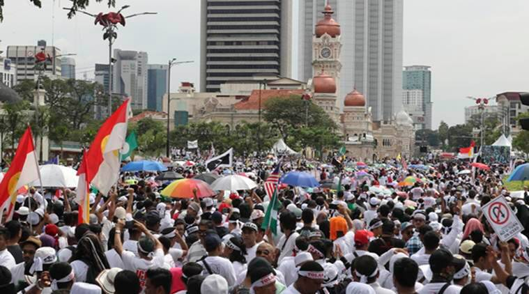 Malaysia Muslims rally, malaysia rally, protest against treaty over anti discrimination, protestors welcome govt move, world news, indian express