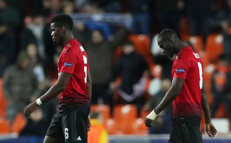 Manchester United's Paul Pogba and Eric Bailly react after the match against Valencia