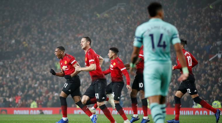 Manchester United's Anthony Martial celebrates scoring their first goal with team mates