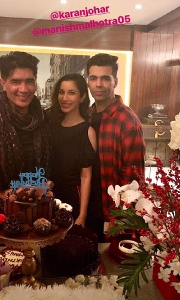 manish malhotra with sophie choudry and karan johar on his birthday