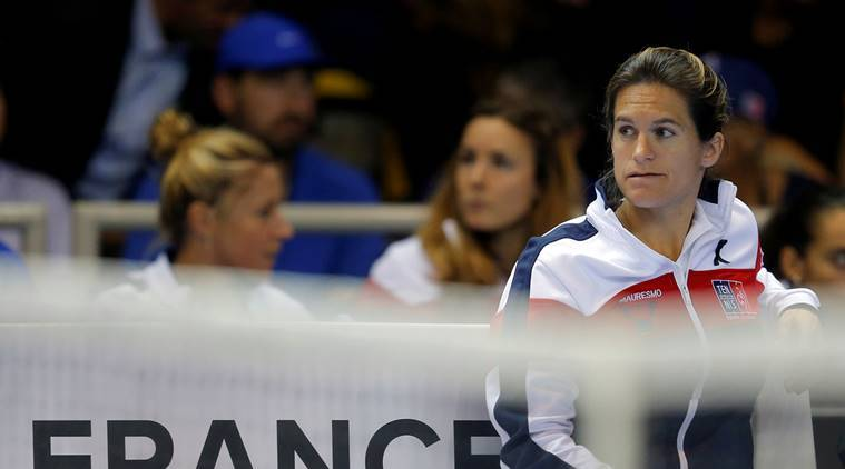France's team captain Amelie Mauresmo watches a match.