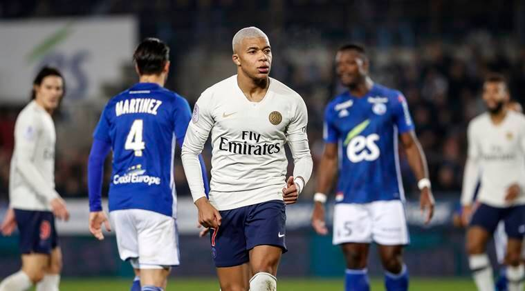 PSG's Kylian Mbappe, center, runs during the League One soccer match between Strasbourg and Paris Saint Germain at the Stade de la Meinau stadium in Strasbourg