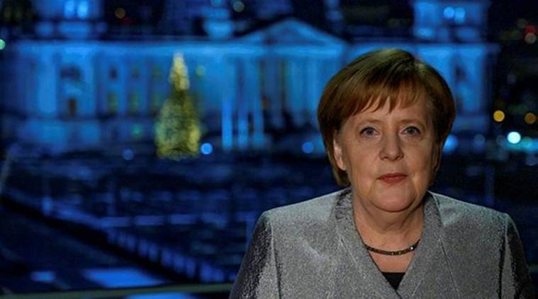 German Chancellor Angela Merkel poses for a photograph after the recording of her annual New Year's speech at the Chancellery in Berlin on Sunday. (Reuters)