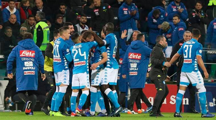 Napoli players celebrates victory at the end of the Italian Serie A soccer match between Cagliari and Napoli at the Sardegna Arena stadium in Cagliari, Italy
