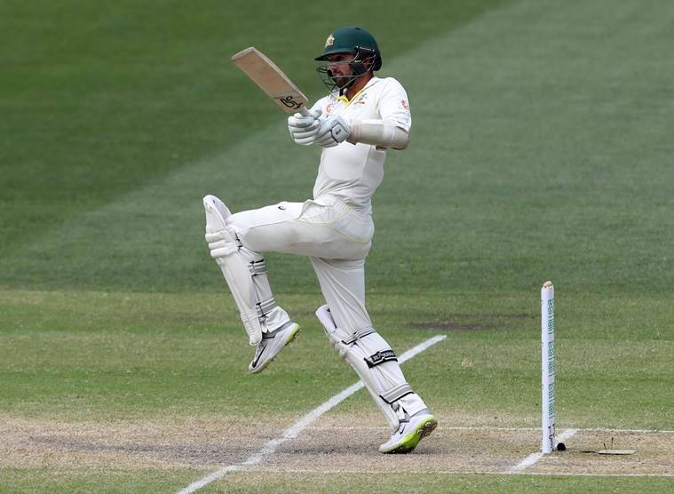 Nathan Lyon bats on the final day of the first cricket test between Australia and India in Adelaide, Australia