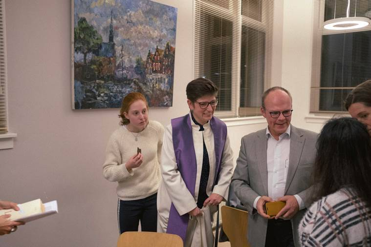 Pastors Rosaliene Israel, the secretary general of Protestant Church Amsterdam, and Derk Stegeman speak with Hayarpi Tamrazyan, right, an Armenian refugee, at Bethel Church, in The Hague, Netherlands.