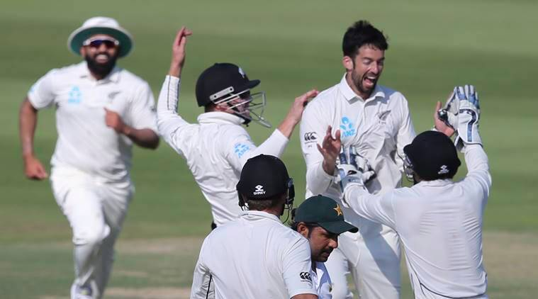 New Zealand's players celebrate dismissal of Pakistan's Sarfraz Ahmed in their test match in Abu Dhabi