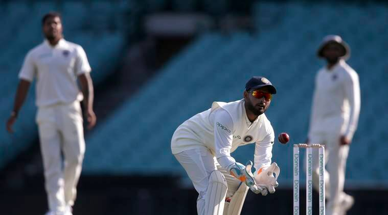 India's Rishabh Pant, center, catches the ball during their tour cricket match against Cricket Australia XI in Sydney