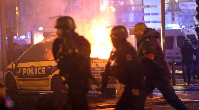 France protests: Stunned Parisians clean up posh central district after worst riots since 1968