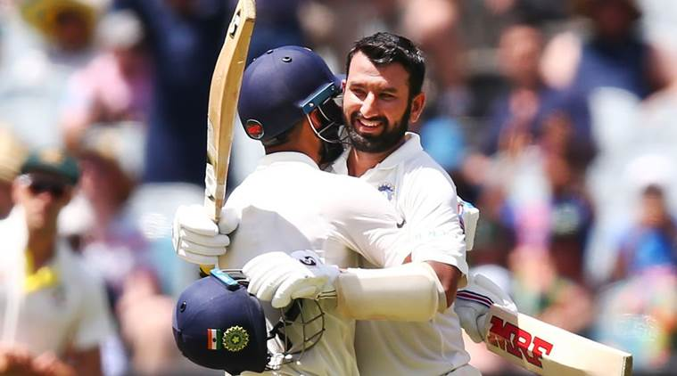 India's Cheteshwar Pujara celebrates after reaching a century during the first cricket test between Australia and India in Adelaide, Australia
