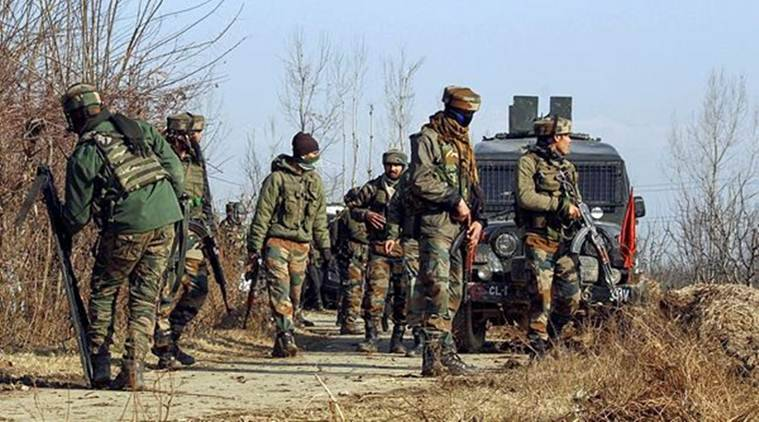 Army soldiers take positions during an encounter with the militants at Sirnoo in Pulwama district. (Photo credits: PTI)
