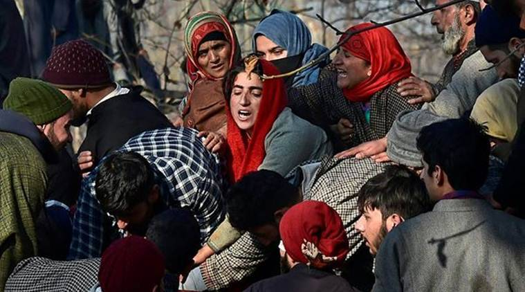 Villagers wail while attending the funeral of civilians and militants who were killed in the encounter today. (Photo credit: PTI)