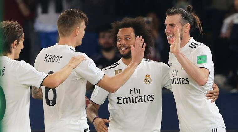 Real Madrid's midfielder Gareth Bale, right, celebrates after scoring his side's third goal during the Club World Cup semifinal soccer match between Real Madrid and Kashima Antlers at Zayed Sports City stadium in Abu Dhabi, United Arab Emirates