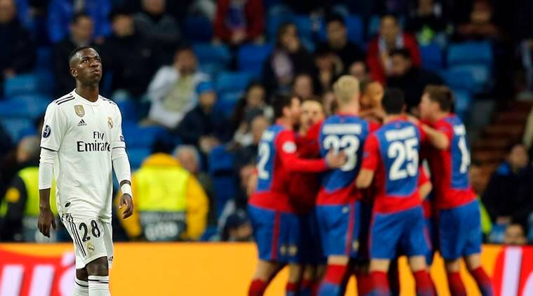 Real Madrid forward Vinicius Junior looks up as CSKA players celebrate in background their side's third goal, during the Champions League, Group G soccer match between Real Madrid and CSKA Moscow, at the Santiago Bernabeu stadium in Madrid