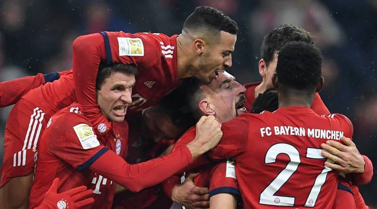 Bayern Munich's Franck Ribery celebrates scoring their first goal with team mates