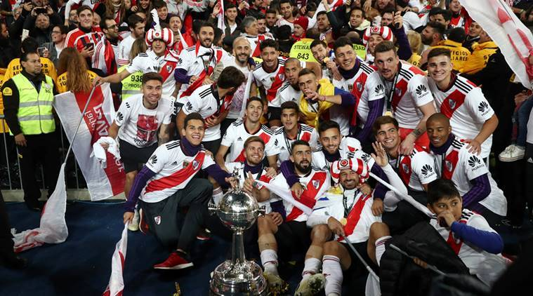 River Plate players celebrate with the trophy after winning the Copa Libertadores final