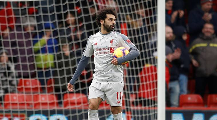 Liverpool's Mohamed Salah with the match ball at the end of the match against Bournemouth in the English Premier League