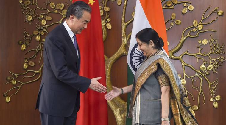 Wang Yi, Sushma swaraj, bilateral talks, Confucius Institutes, pilgrimage tours, indo-china relations, indian express
