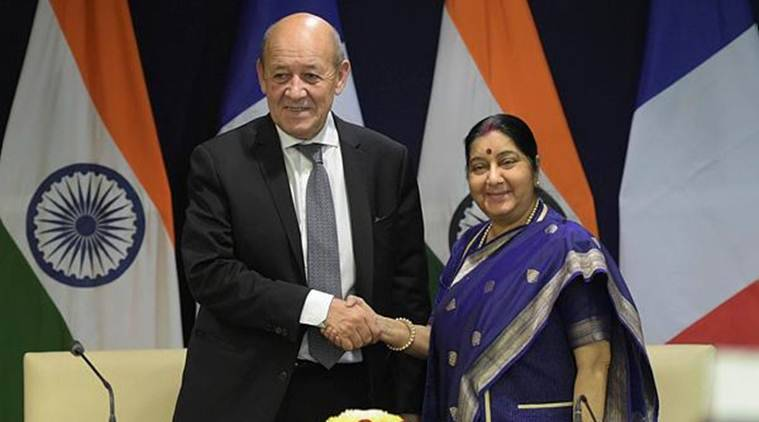 External Affairs Minister Sushma Swaraj and Minister of Europe and Foreign Affairs of France Jean-Yves Le Drian exchange greetings after their joint press statement in New Delhi on Saturday. (Photo credit: PTI)